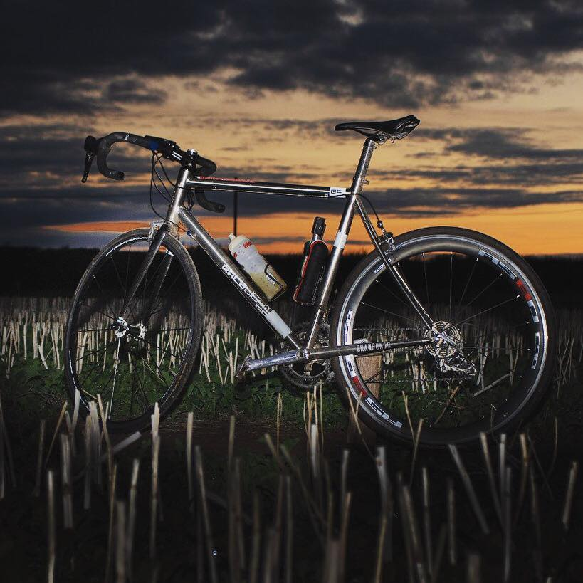Photograph of Richi's bike infront of a sunset before the 200 mile ride